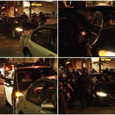 20 POLICAJACA HAPSILO DVOJE STUDENATA: Razbili stakla na kolima, izbušili gume i izvukli ih napolje (VIDEO)