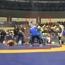 BRUTALNA TUČA NA RVANJU: Pao je šamar, a onda je uleteo OGROMAN čovek sa klupe i patosirao takmičara! (VIDEO)