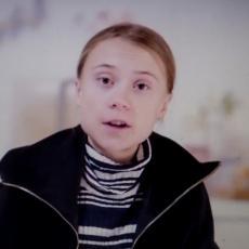 ČINI SE KAO VRLO SREĆAN STARAC KOJI SE RADUJE PREDIVNOJ BUDUĆNOSTI Greta Tunberg se izrugala Trampu (FOTO)