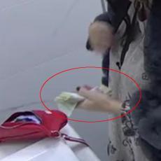 EVO GDE JE NESTAO UKRADENI NOVAC: Ona ga ubacila u brushalter - VIDITE LOPOVA! (VIDEO)