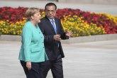 Merkel: Samo mirno