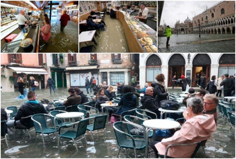 NESTVARNE SLIKE IZ VENECIJE: Voda im do kolena, ali sede u kafićima i prodavnicama kao da se ništa nije dogodilo! Turistima ni potop nije problem (FOTO, VIDEO)