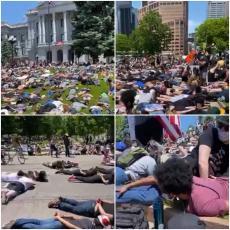 Ne mogu da dišem: Demonstranti ležali na zemlji i IZGOVARALI POSLEDNJE REČI BRUTALNO UBIJENOG FLOJDA (VIDEO)