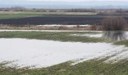 Nevreme u opštini Lučani poplavilo njive i oštetilo puteve