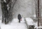 Oblačno, ponegde sa snegom i kišom  od -2 do 10�C