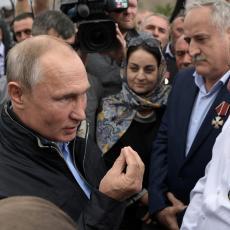 Putin ispunio obećanje staro 20 godina: Popio je čašicu votke koju je odbio još 1999. godine (VIDEO)