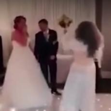 ZAUSTAVITE VENČANJE, JA SAM MLADA! Devojka u venčanici prekinula svadbu i počela da TUČE MLADOŽENJU (VIDEO)