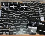 Zaplenjene  adidas  i  najk  etikete spremne za fejk garderobu i patike
